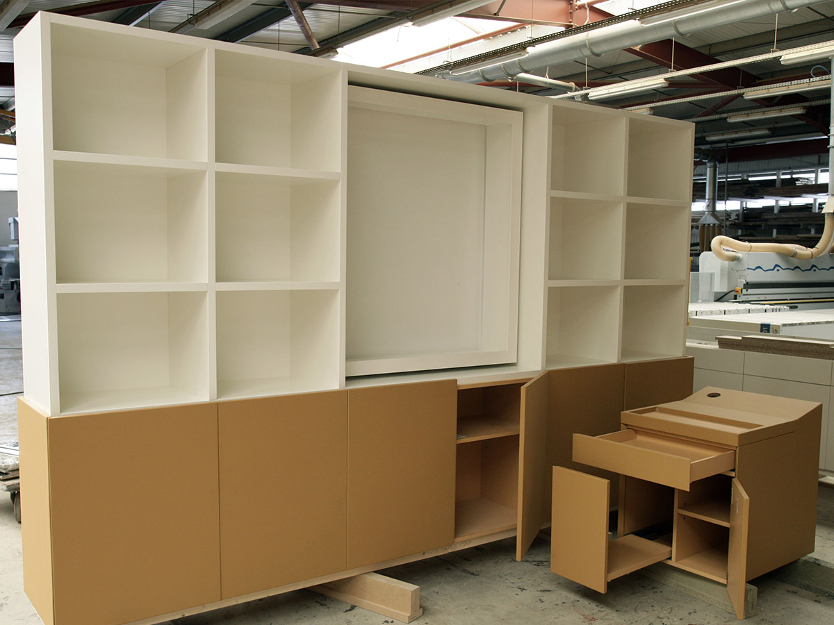 Bookcase furniture, high part in corian, low part in leather