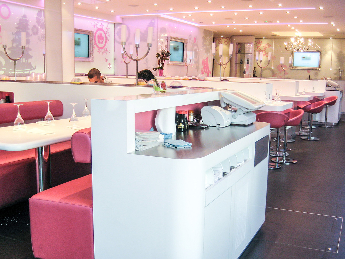 Bright white laminate service, corian table, chain restaurant layout